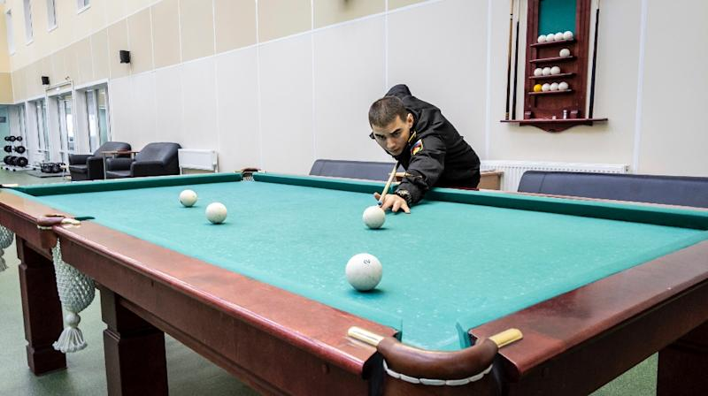 Keen to attract volunteers to the faraway base, the Russian military advertises its modern facilities that include ping-pong and billiard tables, a sauna, a cafeteria and a gym (AFP Photo/Maxime POPOV)