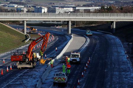 FILE PHOTO: Construction takes place on the Western Peripheral Route in Aberdeen, Scotland, Britain January 17, 2018. Picture taken January 17, 2018. REUTERS/Russell Cheyne /File Photo