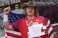 Ryan Crouser, of United States, celebrates after winning the final of the men's shot put at the 2020 Summer Olympics, Thursday, Aug. 5, 2021, in Tokyo. (AP Photo/Matthias Schrader)