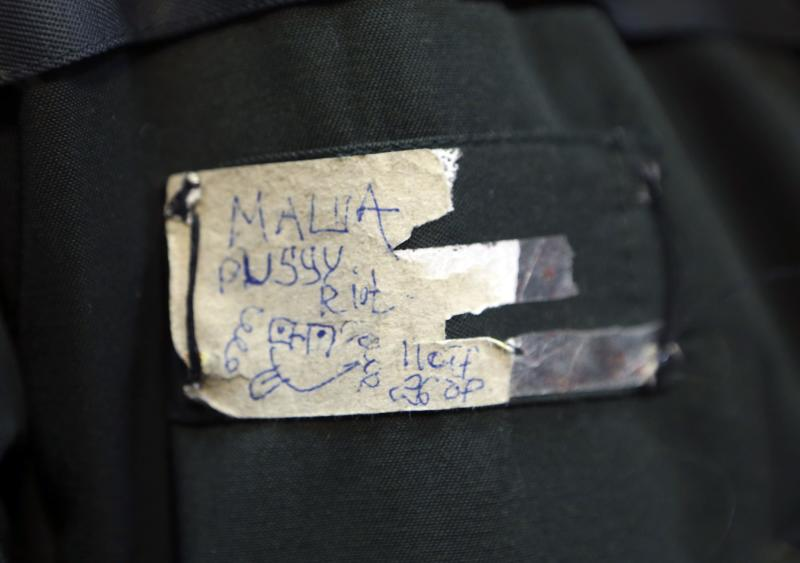 """A close up of the coat badge of Maria Alyokhina, member of Russian punk band Pussy Riot, as she speaks to the media after her release from a penal colony in Nizhny Novgorod December 23, 2013. Alyokhina walked free from jail on Monday under an amnesty allowing her early release from a two-year sentence for a protest in a church against President Vladimir Putin. The badge reads, """"Masha Pussy Riot."""" REUTERS/Sergei Karpukhin (RUSSIA - Tags: POLITICS CRIME LAW)"""