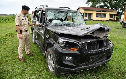 Gulshan Daolagupu, deputy superintendent of police, discusses the vehicle in which two men were lynched in Karbi Anglong district, some 180km from Guwahati, the capital of Indias northeastern state of Assam, at Dokmoka Police station on July 10, 2018