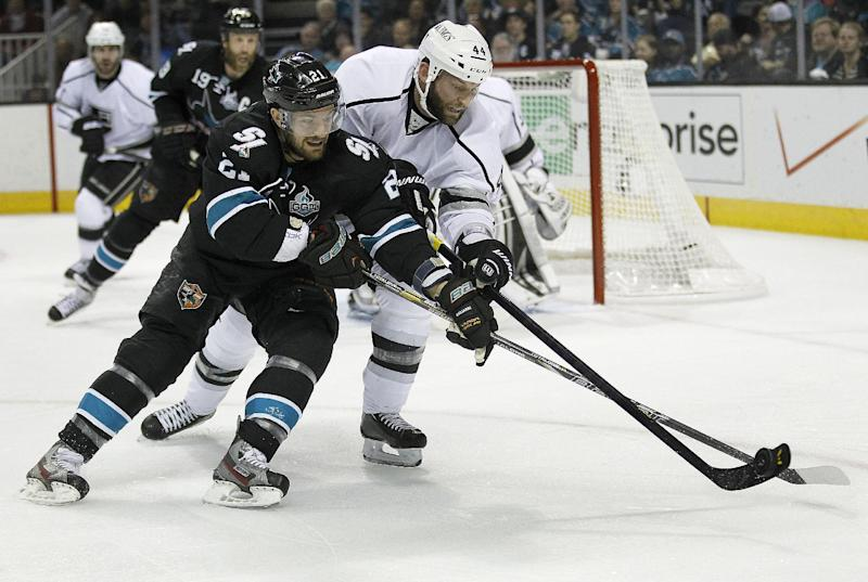San Jose Sharks left wing T.J. Galiardi (21) battles for the puck against Los Angeles Kings defenseman Robyn Regehr (44), of Brazil, during the first period in Game 6 of their second-round NHL hockey Stanley Cup playoff series in San Jose, Calif., Sunday, May 26, 2013. (AP Photo/Tony Avelar)