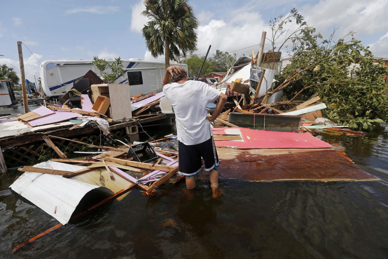 <p><strong>Immokalee</strong><br />Larry Dimas walks around his destroyed trailer, which he rents out to others, in the aftermath of Hurricane Irma in Immokalee, Fla., Sept. 11, 2017. His tenants evacuated and nobody was inside when it was destroyed. (Photo: Gerald Herbert/AP) </p>