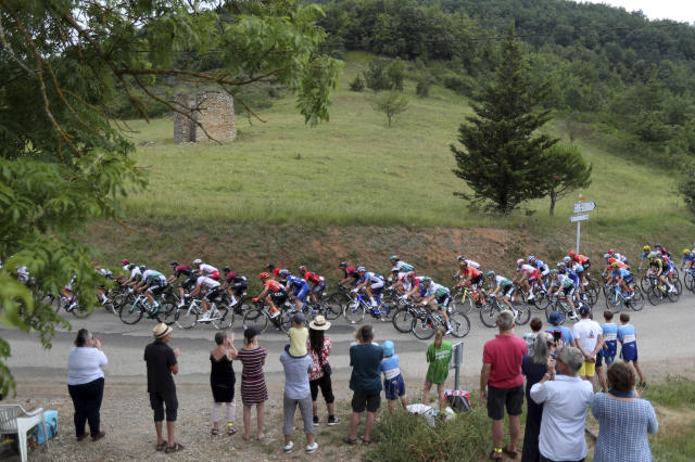 Spectators watch the riders during the fifteenth stage of the Tour de France cycling race over 185 kilometers (114,95 miles) with start in Limoux and finish in Prat d'Albis, France, Sunday, July 21, 2019. (AP Photo/Thibault Camus)
