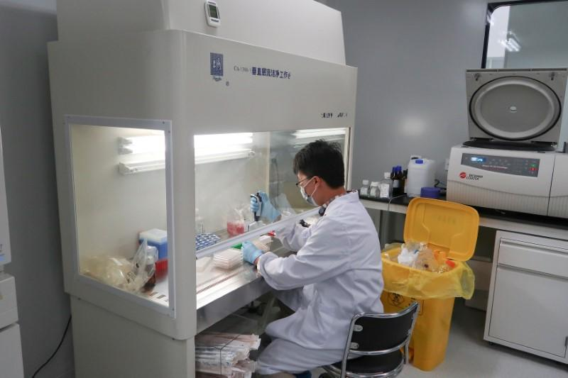 A scientist works at Zai Labo's drug development facility in Shanghai