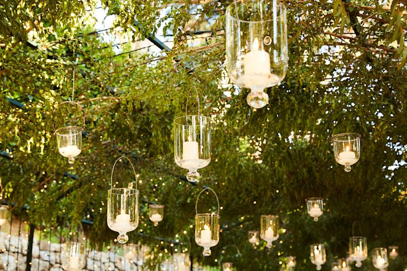 Everyone was seated one long table under a canopy of greenery strung with lights and hanging candles.