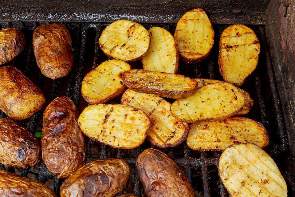 """<p>Grilling starchy vegetables, like potatoes or broccoli, can be a delicious and unique way to prepare them. But make sure you do it right. Dr. Joel Fuhrman, chef and New York Times best-selling author of <a href=""""https://artoflivingretreatcenter.org/"""" rel=""""nofollow noopener"""" target=""""_blank"""" data-ylk=""""slk:The Art of Living Retreat Center"""" class=""""link rapid-noclick-resp""""><em>The Art of Living Retreat Center</em></a>, tells Woman's Day that you should """"soak or marinate them first in a water-vinegar mix."""" This adds to their water content and helps minimize the production of acrylamide, which he explains is """"a cooking-related carcinogen formed when starches are cooked at high temperatures."""" </p>"""