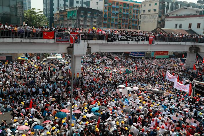 <p>Anti-coup protesters gather at an intersection in Myanmar's biggest city, Yangon, on 22 February 2021</p> (AP)
