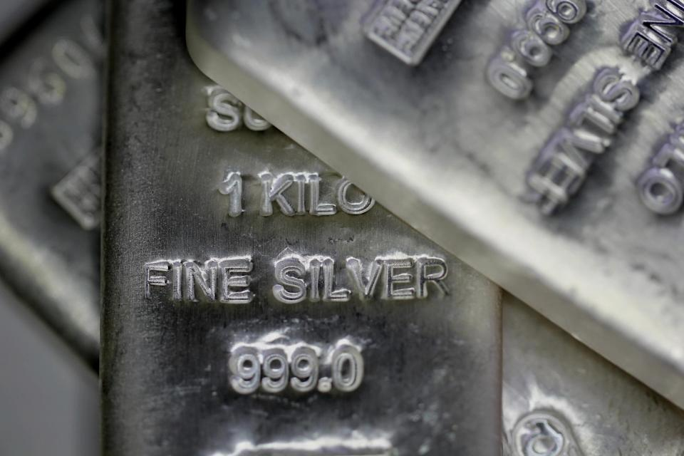 Bars of silver engraved with weight and purity markings.