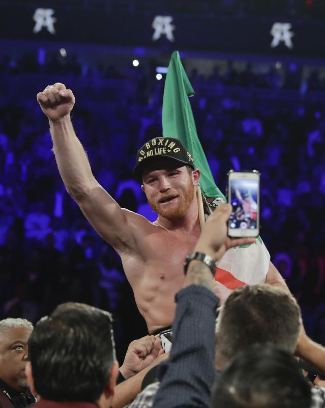 Canelo Alvarez celebrates after defeating Gennady Golovkin by majority decision in a middleweight title boxing match, Saturday, Sept. 15, 2018, in Las Vegas. (AP Photo/Isaac Brekken)