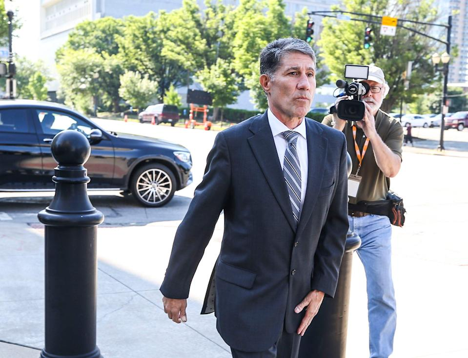 Former assistant coach Dino Gaudio walks towards the Gene Snyder Federal Courthouse on Broadway in Louisville Friday morning, Gaudio would enter a guilty plea to his UofL extortion case. His sentencing is Aug. 27 June 4, 2021