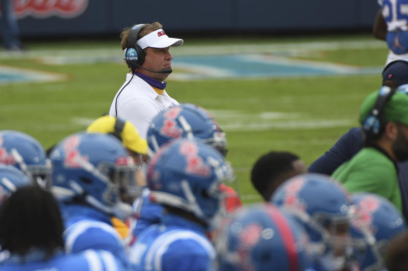 Mississippi head coach Lane Kiffin watches on from the sideline during the first half of an NCAA college football game Florida on Saturday, Sept. 26, 2020, in Oxford, Miss. (AP Photo/Thomas Graning)