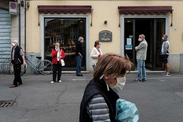 PHOTO: People queue using social distancing outside a patisserie in Codogno, the small northern town where Italy's first patient was diagnosed with the coronavirus disease, as the country begins a staged end to a nationwide lockdown, May 5, 2020. (Marzio Toniolo via Reuters)