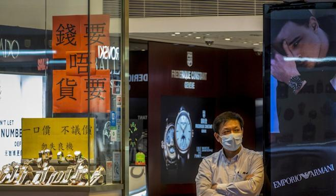 A salesman waits for customers at a store in Causeway Bay in Hong Kong. Photo: Sun Yeung