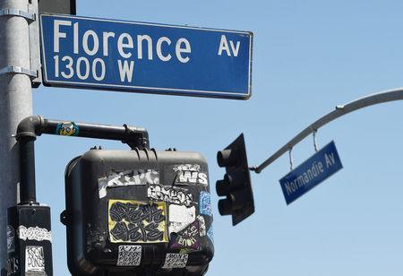 A view of the streets signs in the intersection of Florence and Normandie Avenue, the flashpoint where the riots started 25 years ago, in Los Angeles, California, U.S., April 29, 2017. REUTERS/Kevork Djansezian