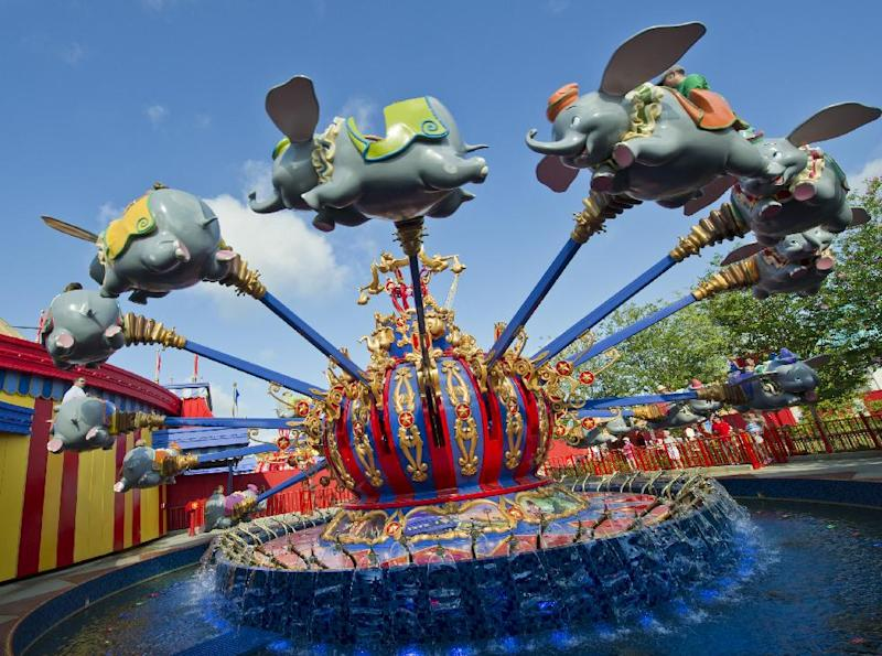 """In this May 12, 2012 photo released by Disney theme parks, people ride the """"Dumbo the Flying Elephant,"""" attraction in the new Storybook Circus area of Fantasyland at Magic Kingdom Park in Lake Buena Vista, Fla. The renovation and new construction at Fantasyland inside the Magic Kingdom in Florida is the largest expansion project in the park's 40-year history, doubling the size of the current Fantasyland. (AP Photo/Disney, Gene Duncan)"""