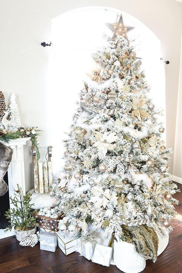 """<p>If your flocked Christmas tree has seen better days, give it new life by wrapping it with fluffy white garland and adding white poinsettias in sparse areas. </p><p><em><a href=""""https://apumpkinandaprincess.com/gold-silver-winter-wonderland-tree/"""" rel=""""nofollow noopener"""" target=""""_blank"""" data-ylk=""""slk:Get the tutorial at A Pumpkin & A Princess »"""" class=""""link rapid-noclick-resp"""">Get the tutorial at A Pumpkin & A Princess »</a></em> </p>"""