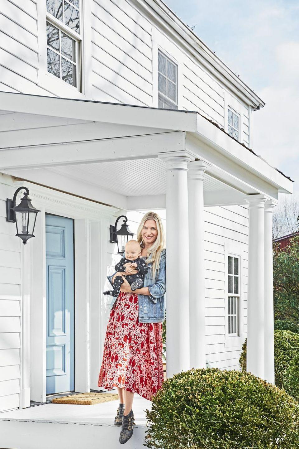 """<p>A crisp white exterior gets broken up with a delicate shade of baby blue and gray metal lights.</p><p><a class=""""link rapid-noclick-resp"""" href=""""https://go.redirectingat.com?id=74968X1596630&url=https%3A%2F%2Fwww.homedepot.com%2Fp%2FBEHR-ULTRA-1-gal-MQ3-24-Celestial-Light-Semi-Gloss-Enamel-Interior-Paint-and-Primer-in-One-375001%2F303935130&sref=https%3A%2F%2Fwww.countryliving.com%2Fhome-design%2Fcolor%2Fg31158913%2Ffront-door-colors%2F"""" rel=""""nofollow noopener"""" target=""""_blank"""" data-ylk=""""slk:SHOP BLUE PAINT"""">SHOP BLUE PAINT</a></p>"""