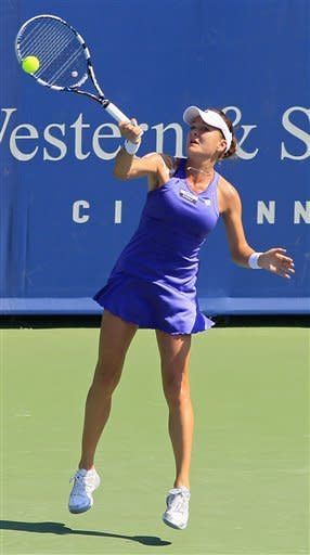 Agnieszka Radwanska, from Poland, hits a forehand against Sofia Arvidsson, from Sweden, during a match at the Western & Southern Open tennis tournament, Wednesday, Aug. 15, 2012, in Mason, Ohio. (AP Photo/Al Behrman)