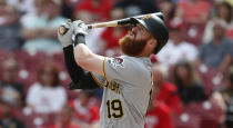 Pittsburgh Pirates' Colin Moran (19) watches his three-run home run off Cincinnati Reds starting pitcher Anthony DeSclafani (28) during the sixth inning of a baseball game, Wednesday, May 29, 2019, in Cincinnati. (AP Photo/Gary Landers)
