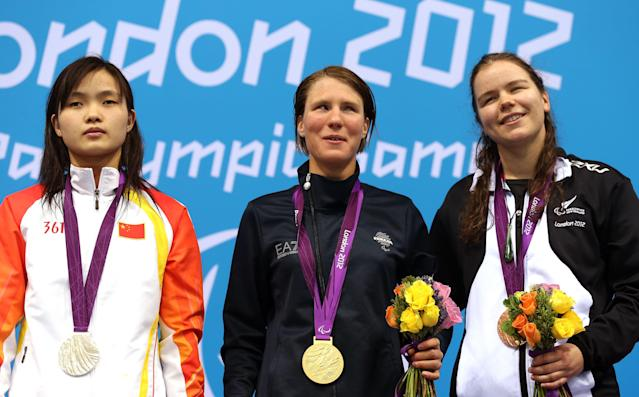 LONDON, ENGLAND - SEPTEMBER 01: (L-R) Silver medallist Guizhi Li of China, gold medallist Cecilia Camellini of Italy and bronze medallist Mary Fisher of New Zealand pose on the podium during the medal ceremony for the Women's 50m Freestyle - S11 Final on day 3 of the London 2012 Paralympic Games at Aquatics Centre on September 1, 2012 in London, England. (Photo by Clive Rose/Getty Images)