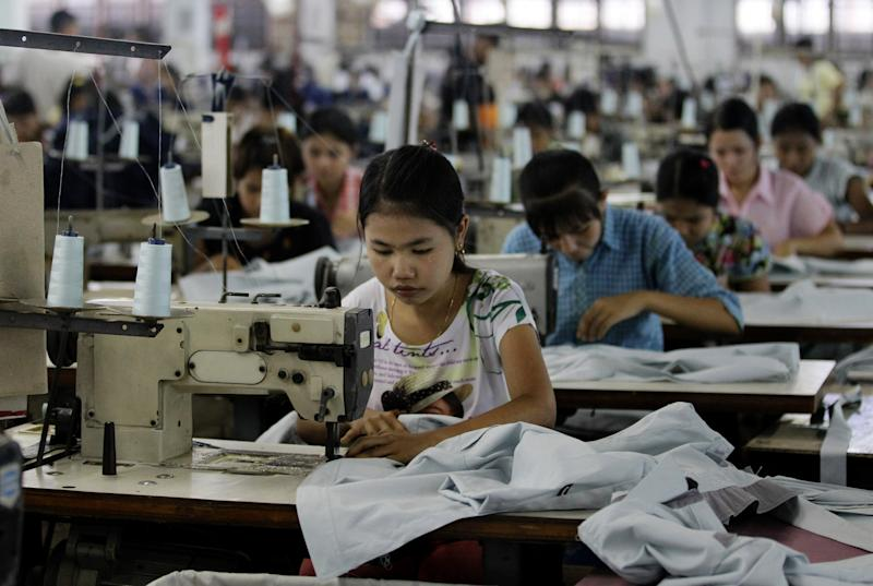 In this April 21, 2012 photo, young workers use sewing machines at a garment factory in Yangon, Myanmar. The European Union confirmed Monday, April 23, 2012, that it was suspending most of its sanctions against Myanmar to reward the country's recent wave of political reform. The suspension of trade sanctions could help revive the nation's industries, restoring some of the 80,000 garment industry jobs lost here over the past 10 years. (AP Photo/Sakchai Lalit)