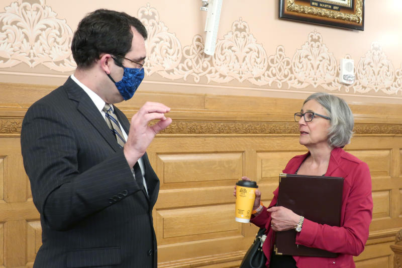 Kansas Attorney General Derek Schmidt, left, confers with Kansas Senate President Susan Wagle, R-Wichita, ahead of a Senate committee meeting on the governor's power in a pandemic, Tuesday, May 19, 2020, at the Statehouse in Topeka, Kan. Wagle and other GOP lawmakers are looking to curb the governor's power in emergencies and have asked for advice from Schmidt, also a Republican, on how to proceed. (AP Photo/John Hanna)