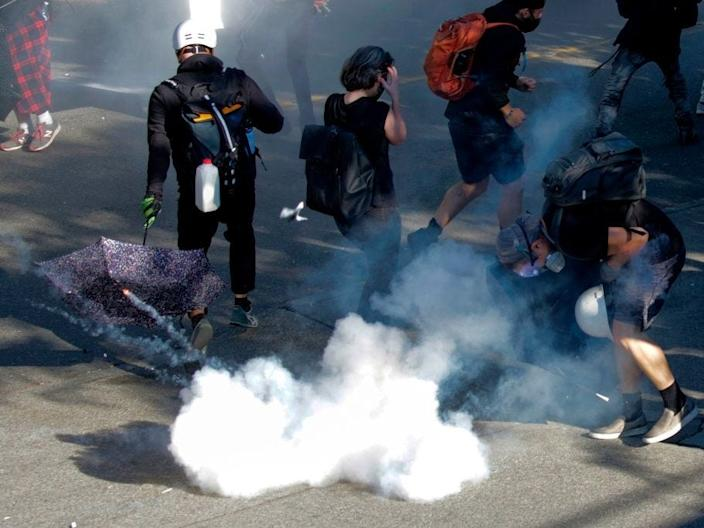 """A blast ball detonates as police clash with protesters following the """"Youth Day of Action and Solidarity with Portland"""" demonstration in Seattle, Washington on July 25, 2020."""