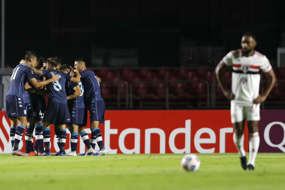 SAO PAULO, BRAZIL - MAY 18: Joaquín Novillo of Racing Club celebrates with teammates after scoring the first goal of his team  during a match between Sao Paulo and Racing Club as part of Group E of Copa CONMEBOL Libertadores 2021 at Morumbi Stadium on May 18, 2021 in Sao Paulo, Brazil. (Photo by Sebastiao Moreira - Pool/Getty Images)