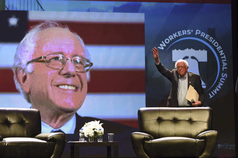"""Democratic presidential candidate U.S. Sen. Bernie Sanders arrives onstage at the """"Workers' Presidential Summit"""" at the Convention Center in Philadelphia Tuesday, Sept. 17, 2019. The Philadelphia Council of the AFL-CIO hosted the event. (Tom Gralish/The Philadelphia Inquirer via AP)"""