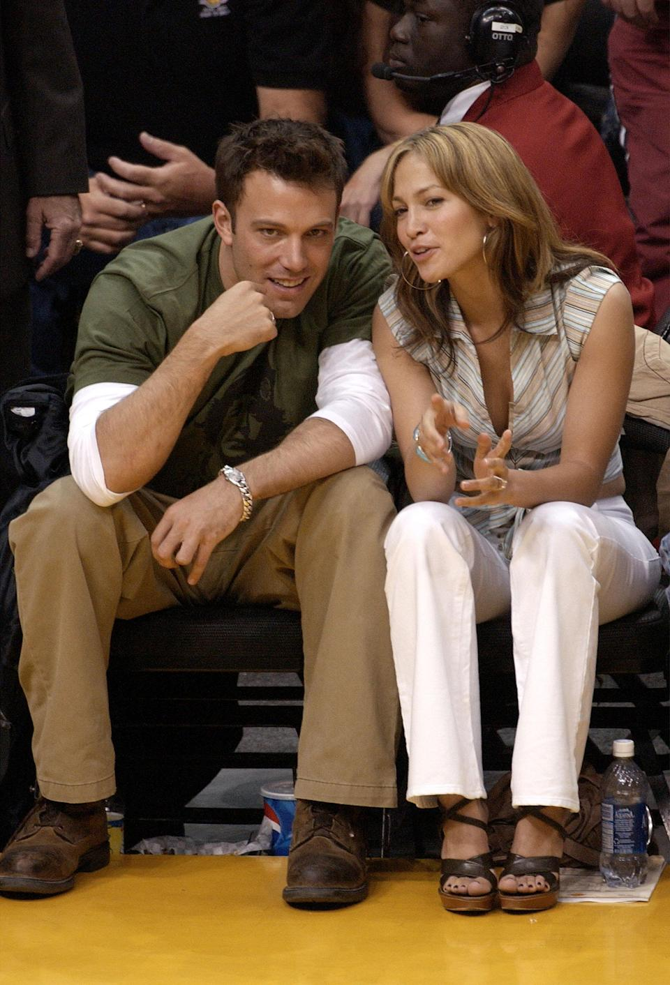 Ben Affleck and Jennifer Lopez attend a Lakers game in 2003. Check that left wrist!