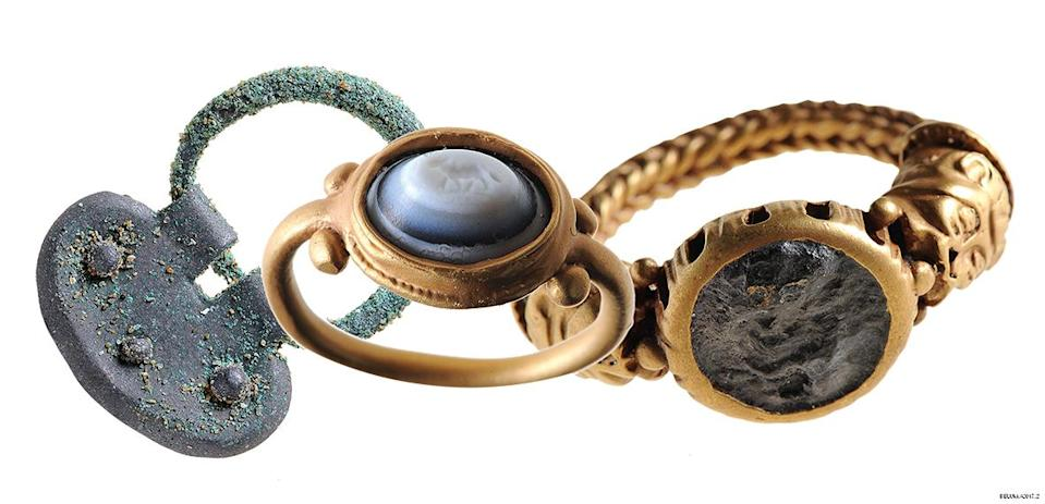Two Roman rings and a section of a belt buckle were found by a member of the public at Murlough in 2014 (NMNI/PA)