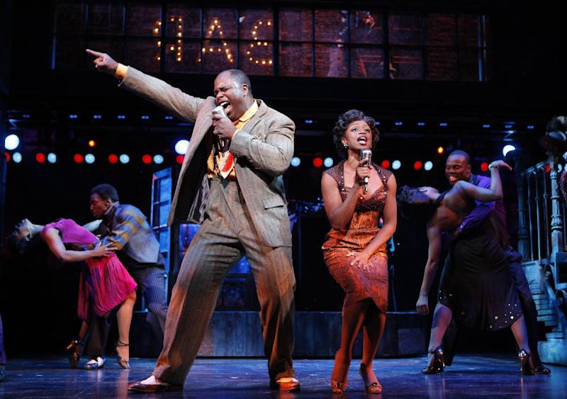 """This theater image released by The Hartman Group shows J. Bernard Calloway, left, and Montego Glover in a scene from the musical """"Memphis."""" Producers said Tuesday, June 26, 2012, that the Joe DiPietro-written musical will play its last performance on Aug. 5 after 30 previews and 1,166 regular performances. It opened in October 2009. (AP Photo/The Hartman Group, Joan Marcus)"""