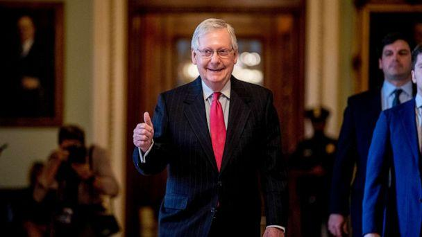 PHOTO: Senate Majority Leader Mitch McConnell gives a thumbs up as he leaves the Senate chamber on Capitol Hill in Washington, March 25, 2020, where a deal has been reached on a coronavirus bill. (Andrew Harnik/AP)