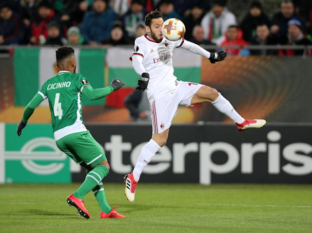 Soccer Football - Europa League Round of 32 First Leg - PFC Ludogorets Razgrad vs AC Milan - Ludogorets Arena, Razgrad, Bulgaria - February 15, 2018 AC Milan's Hakan Calhanoglu in action with Ludogorets' Cicinho REUTERS/Stoyan Nenov