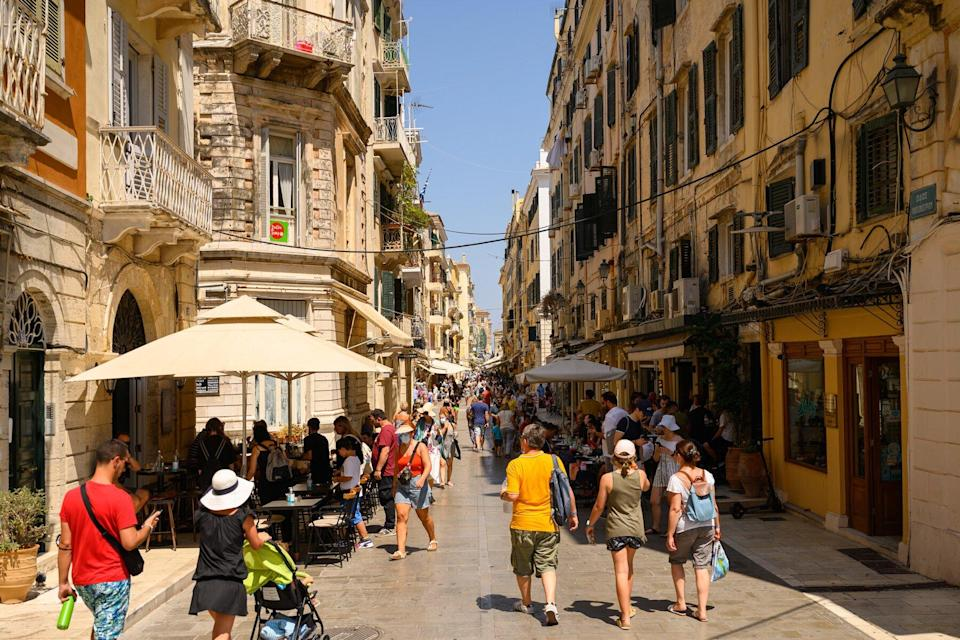 Tourists walk through the streets of the capital of the island.