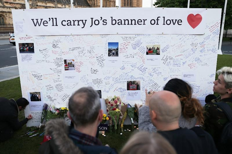 People stand in front of a large board in Parliament Square, central London, bearing messages in remembrance of murdered Labour MP Jo Cox (AFP Photo/Daniel Leal-Olivas)