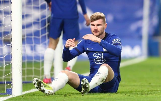Chelsea's Timo Werner sits dejected after missing a chance