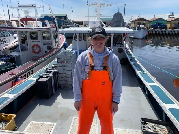 Jada Yeo works on her father's lobster boat out of North Lake, P.E.I., as a 'helper' and is making a career in the fishing industry. She also has her own licence to fish mackerel. (Sara Fraser/CBC - image credit)