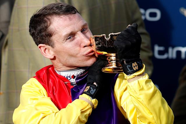 Horse Racing - Cheltenham Festival - Cheltenham Racecourse, Cheltenham, Britain - March 16, 2018 Richard Johnson celebrates with the trophy after riding Native River to victory in the 15.30 Timico Cheltenham Gold Cup Chase REUTERS/Darren Staples