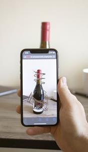 Agency Rock Paper Reality used 8th Wall's Curved Image Targets technology to bring a Siduri Wine bottle to life with web-based augmented reality, no app required.