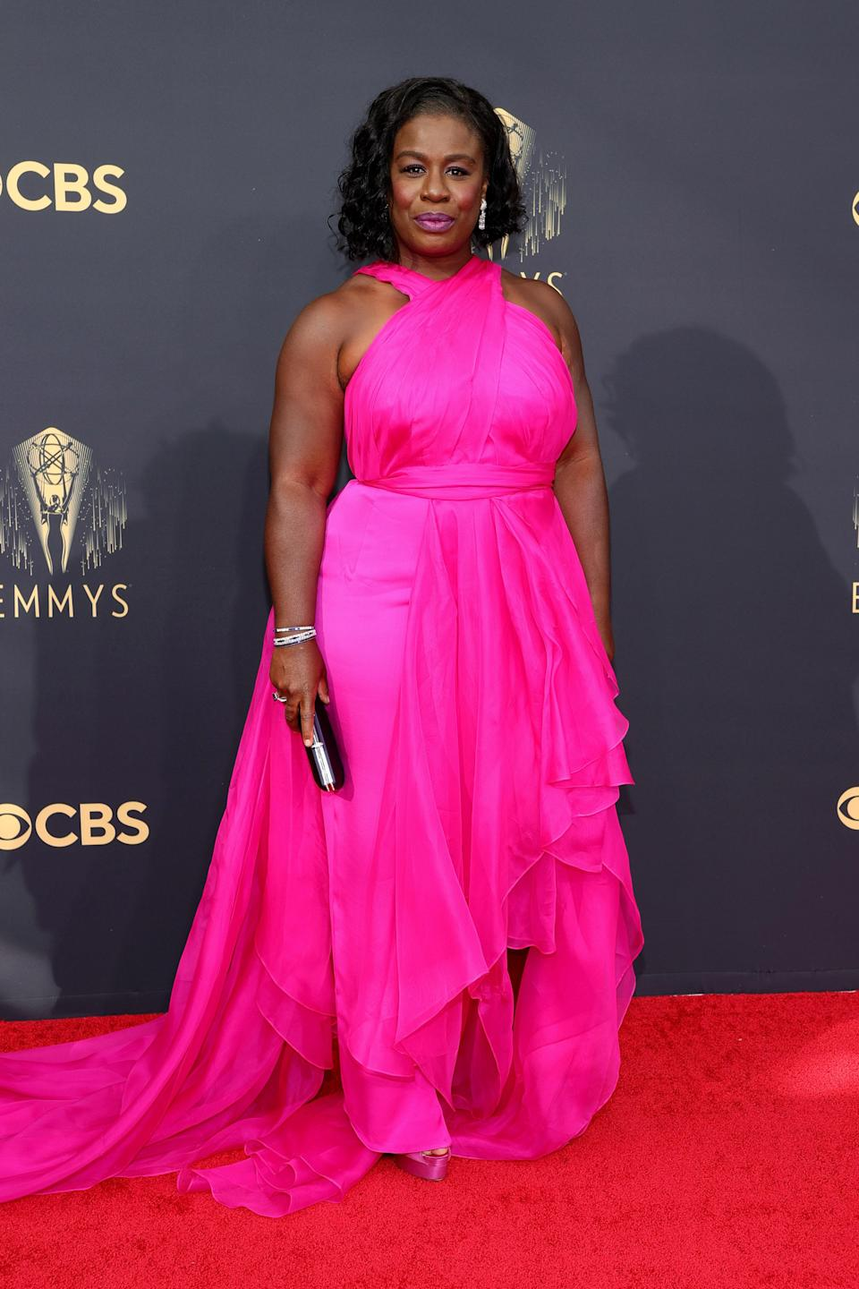 Another vote for hot, hot pink! We're obsessed with Uzo's eye-popping pink gown.