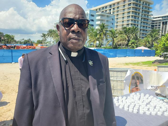 Rev. Bill Minson, of the United States Secret Service, attends a press conference with survivors' families in Surfside, Florida. Sept. 23, 2021.