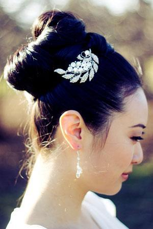 """<div class=""""caption-credit""""> Photo by: Etsy seller SomethingIvory</div><div class=""""caption-title"""">2. Jeweled Clip</div><a rel=""""nofollow noopener"""" href=""""http://www.etsy.com/listing/95010351/reese-rhinstone-encrusted-bridal-hair"""" target=""""_blank"""" data-ylk=""""slk:&quot;Reese&quot; rhinestone-encrusted hair comb"""" class=""""link rapid-noclick-resp"""">""""Reese"""" rhinestone-encrusted hair comb</a> by Etsy seller SomethingIvory. <br> <br> <b>Related: <a rel=""""nofollow noopener"""" href=""""http://www.bridalguide.com/fashion/bridal-jewelry-accessories/engagement-ring-shapes"""" target=""""_blank"""" data-ylk=""""slk:Which Engagement Ring Fits Your Personality?"""" class=""""link rapid-noclick-resp"""">Which Engagement Ring Fits Your Personality?</a></b>"""