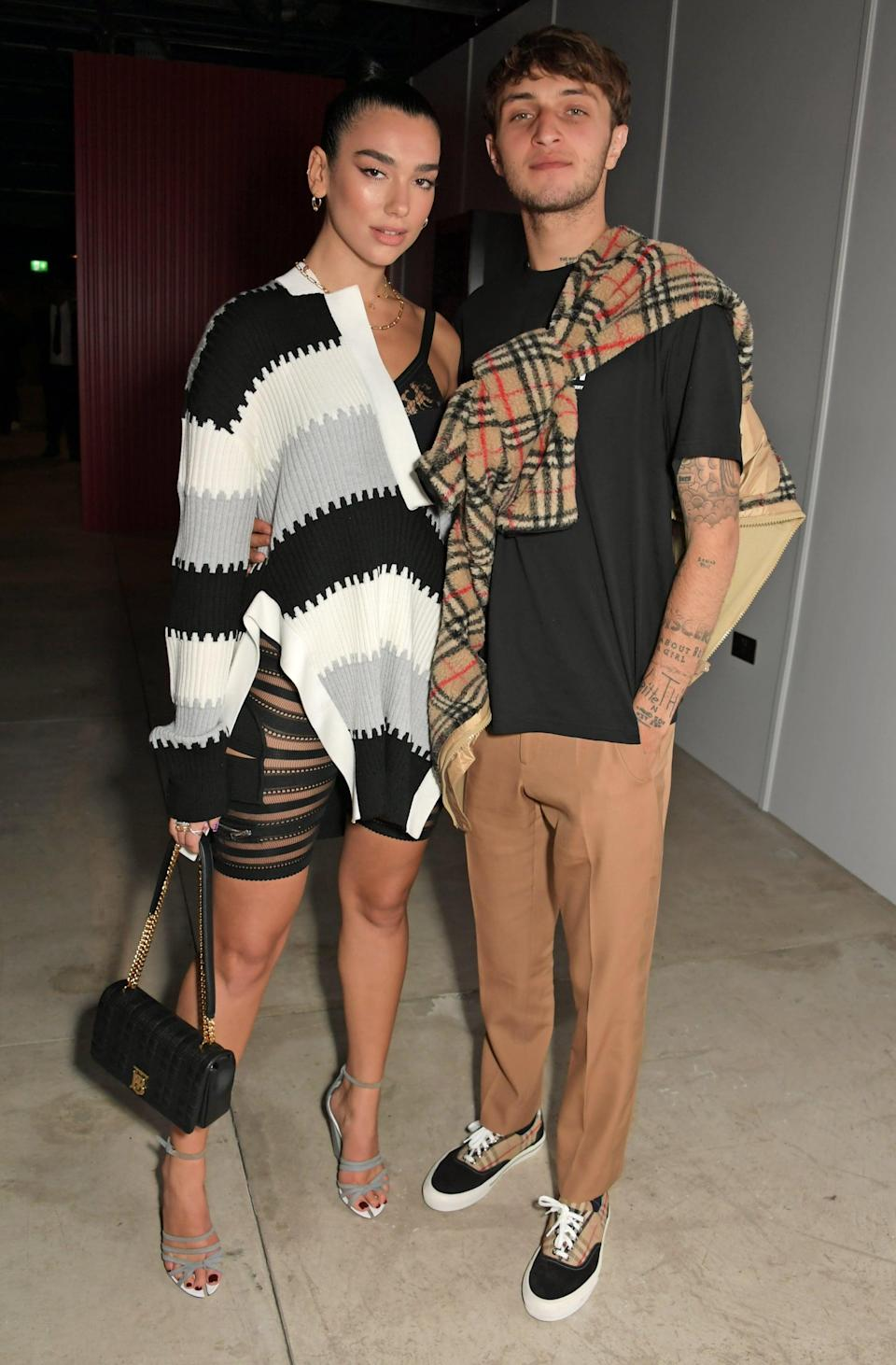 <p>We love how Anwar decided to tie his sweater around one shoulder while Dua decided to slip hers on over a bodysuit. </p>