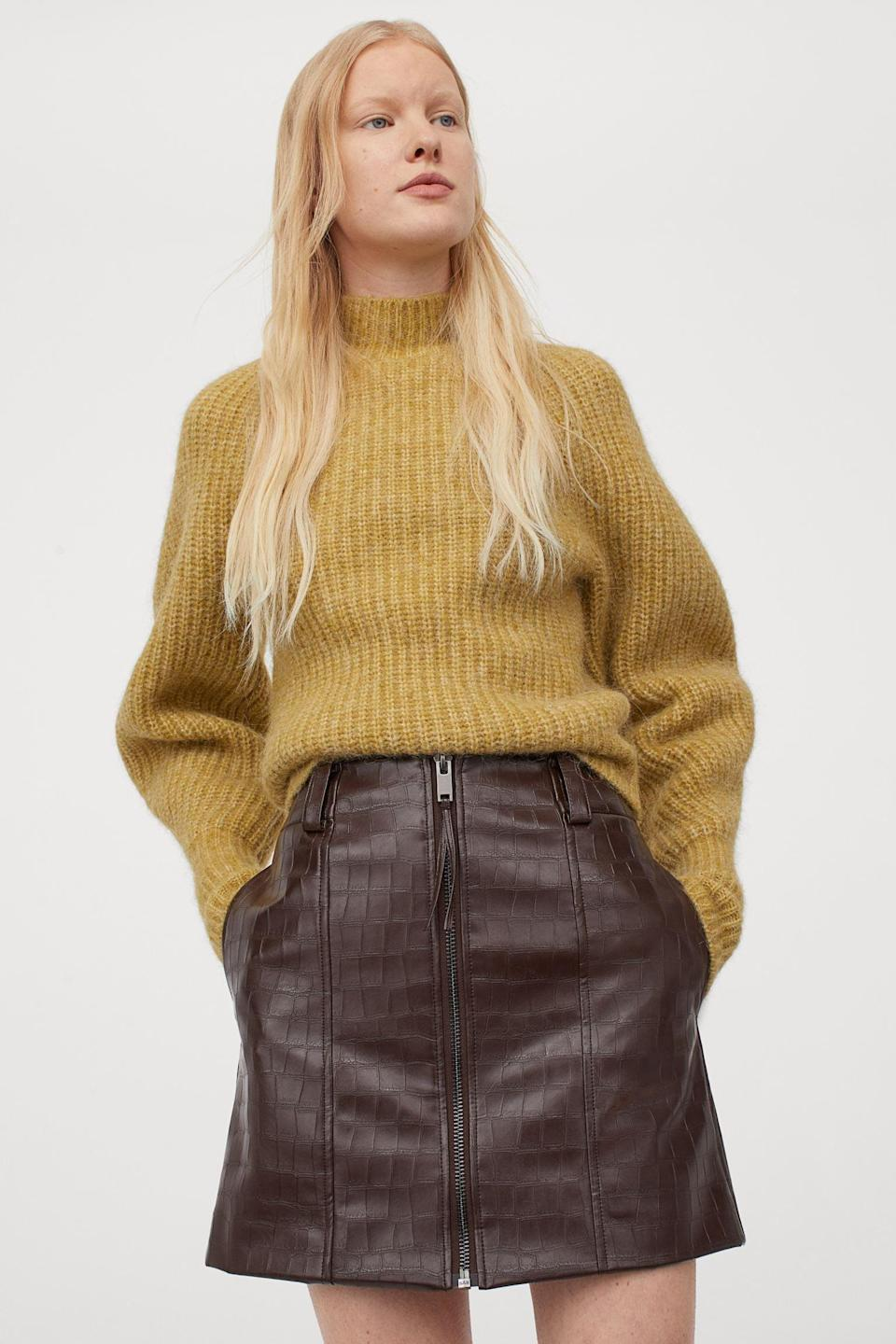 <p>Wear this <span>Crocodile-patterned Short Skirt</span> ($50) with a bright sweater, or keep it neutral with a burnt orange cardigan top.</p>