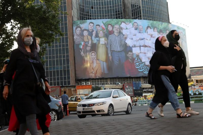 FILE PHOTO: A banner of the presidential election is seen in Valiasr square in Tehran