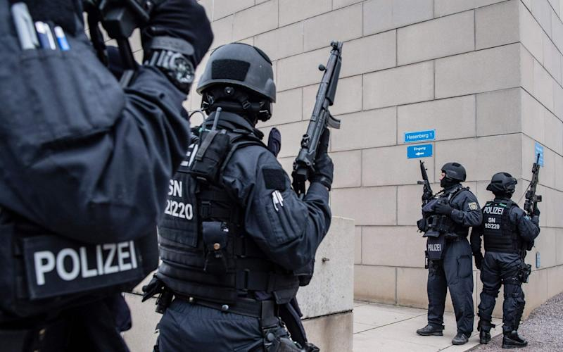 Policemen secure the area around the synagogue Dreseden on October 9. At least two people were killed in a shooting on a street in the German city of Halle - DPA