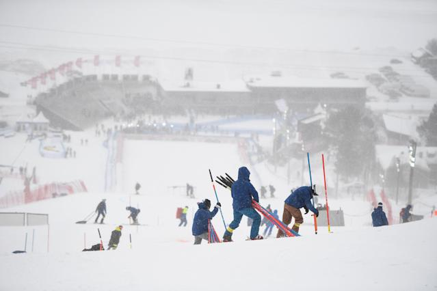 Alpine Skiing - FIS Alpine Skiing World Cup Finals 2018 - Are, Sweden - March 18, 2018. Stewards up stakes in the finish area as the Alpine World Cup races is cancelled due to high winds. TT News Agency/Pontus Lundahl/ via REUTERS ATTENTION EDITORS - THIS IMAGE WAS PROVIDED BY A THIRD PARTY. SWEDEN OUT. NO COMMERCIAL OR EDITORIAL SALES IN SWEDEN
