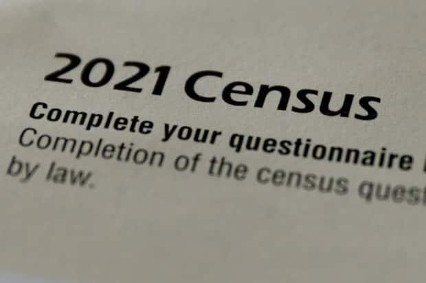 The cover of a questionnaire request sent by Statistics Canada is seen in a photo illustration. The agency hoped to entice people to fill out this year's census with a series of music playlists. (Chris Helgren/Reuters - image credit)